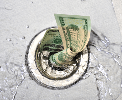 Image of a $50 dollar bill swirling down a drain | metaphor for business wasting money on marketing for trade shows