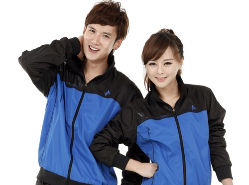 Image of a guy and girl dressed alike in windbreakers | custom corporate apparel for men and women